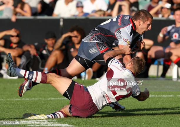 Lewis Brown of the Warriors is tackled by Kyle Lodge of the Sea Eagles during the NRL trial match between the Warriors and the Manly Warringah Sea...