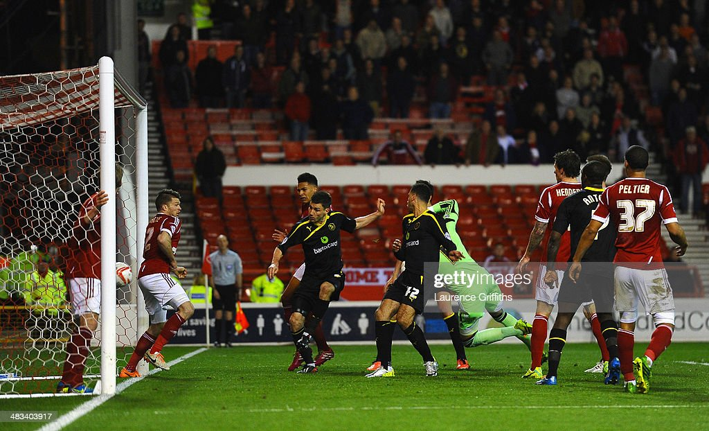 Lewis Buxton of Sheffield Wednesday scores the second goal during the Sky Bet Championship match between Nottingham Forest and Sheffield Wednesday at City Ground on April 8, 2014 in Nottingham, England.