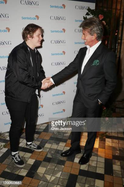 Lewis Capaldi greets Richard Caring as Sentebale held an event on January 19 hosted by Mr Mrs Caring on behalf of The Caring Foundation to raise...