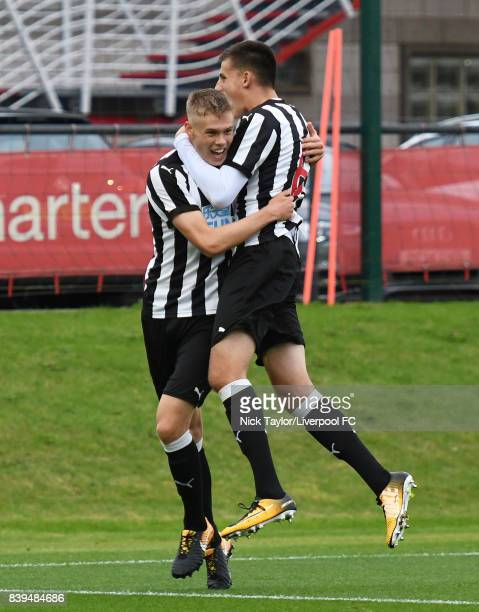 Lewis Cass of Newcastle United celebrates his goal with team mate Kelland Watts during the Liverpool v Newcastle United U18 Premier League game at...