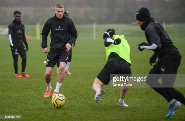 Lewis Cass passes the ball during the Newcastle United Training Session at the Newcastle United Training Centre on January 09 2020 in Newcastle upon...