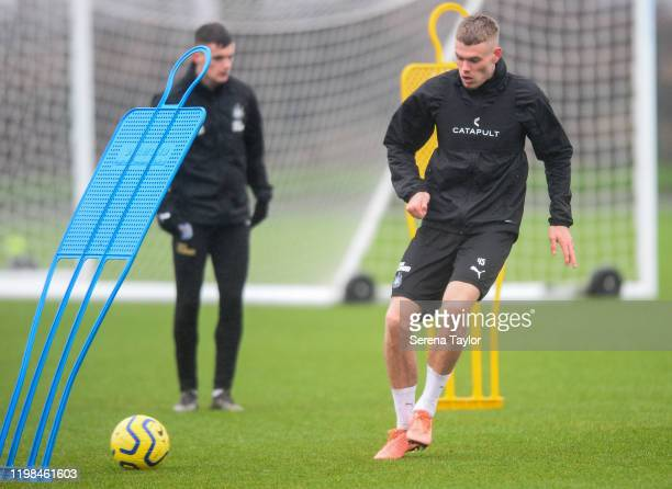 Lewis Cass passes the ball in a drill during the Newcastle United Training Session at the Newcastle United Training Centre on January 09 2020 in...
