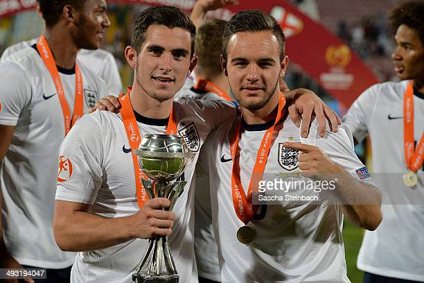 Lewis Cook and Adam Armstrong of England pose with the trophy after winning the UEFA Under17 European Championship 2014 final match against...