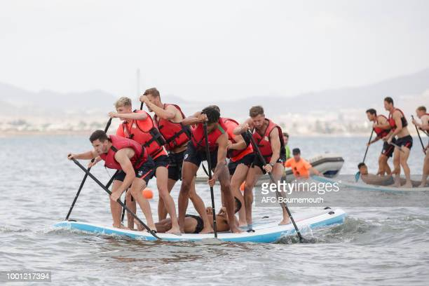 Lewis Cook David Brooks and Tyrone Mings of Bournemouth lead the way during preseason teambuilding exercise involving paddle boards on July 18 2018...