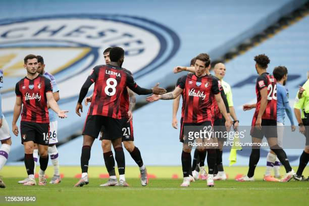 Lewis Cook Jefferson Lerma and Harry Wilson of Bournemouth after their sides 21 defeat during the Premier League match between Manchester City and...