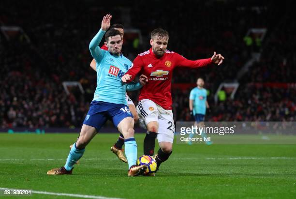 Lewis Cook of AFC Bournemouth and Luke Shaw of Manchester United during the Premier League match between Manchester United and AFC Bournemouth at Old...