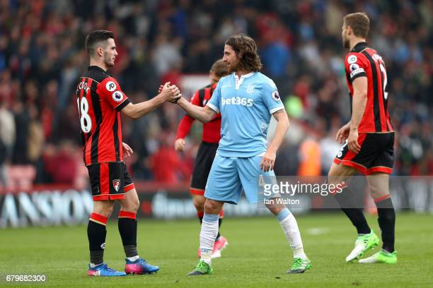Lewis Cook of AFC Bournemouth and Stoke City shake hands after the Premier League match between AFC Bournemouth and Stoke City at the Vitality...