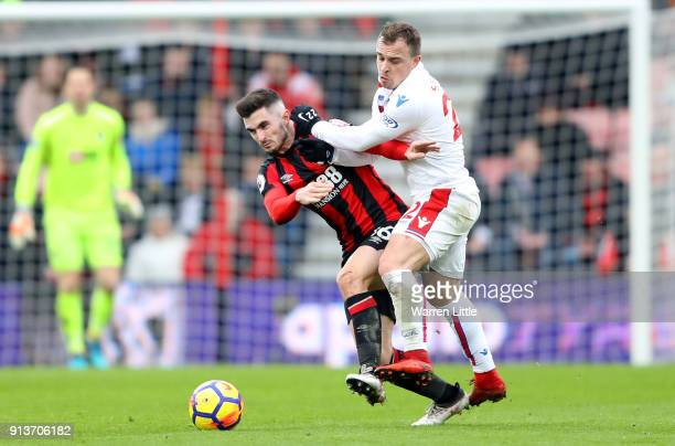 Lewis Cook of AFC Bournemouth and Xherdan Shaqiri of Stoke City battle for possession during the Premier League match between AFC Bournemouth and...