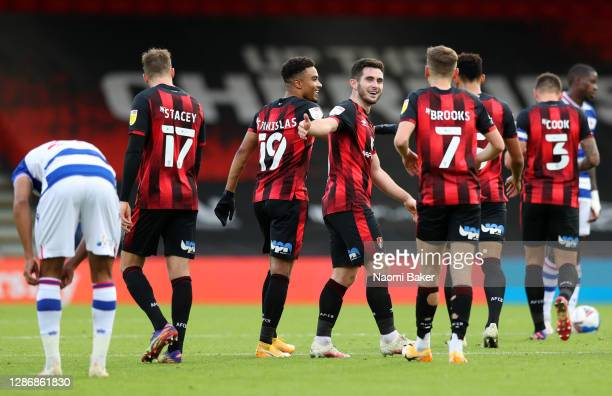 Lewis Cook of AFC Bournemouth celebrates with teammate David Brooks after scoring his team's third goal during the Sky Bet Championship match between...