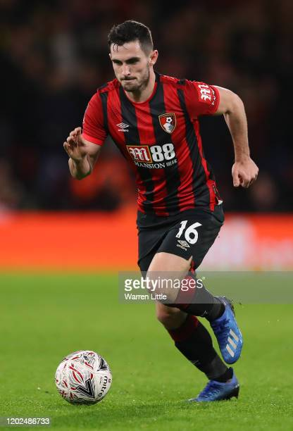 Lewis Cook of AFC Bournemouth controls the ball during the FA Cup Fourth Round match between Bournemouth AFC and Arsenal FC at Vitality Stadium on...