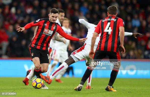 Lewis Cook of AFC Bournemouth runs with the ball during the Premier League match between AFC Bournemouth and Stoke City at Vitality Stadium on...