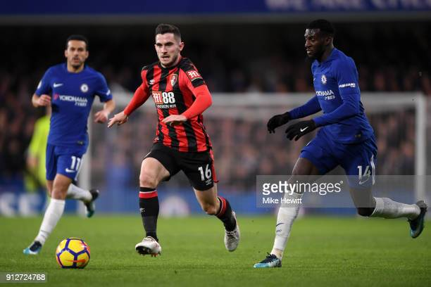 Lewis Cook of AFC Bournemouth runs with the ball under pressure from Tiemoue Bakayoko of Chelsea during the Premier League match between Chelsea and...