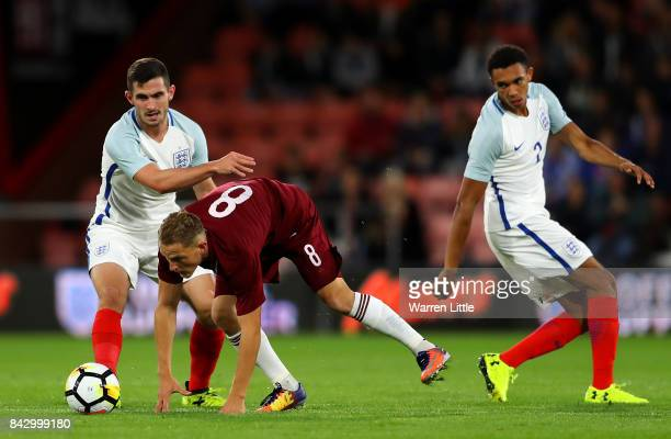 Lewis Cook of England and Andrejs Ciganiks of Latvia in action during the UEFA Under 21 Championship Qualifiers between England and Latvia at...