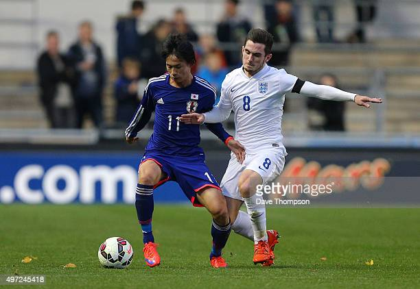 Lewis Cook of England and Koki Sugimori of Japan compete for the ball during the U19 International friendly match between England and Japan at...