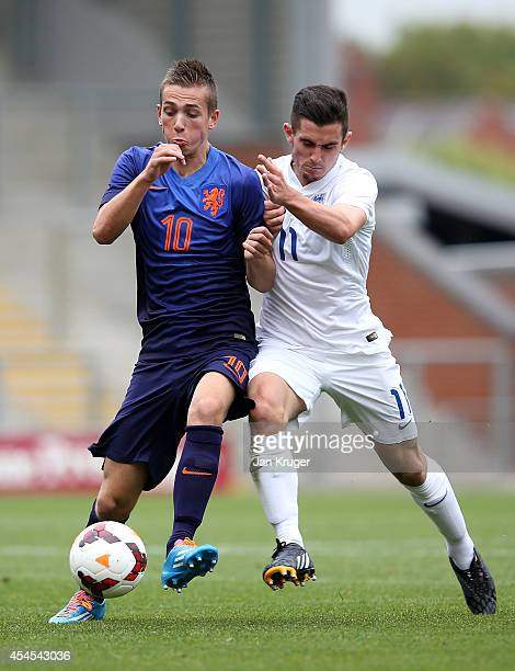 Lewis Cook of England U18 battles with Ruben de Jager of Netherlands U18 during the U18 International Friendly match between England U18 and...