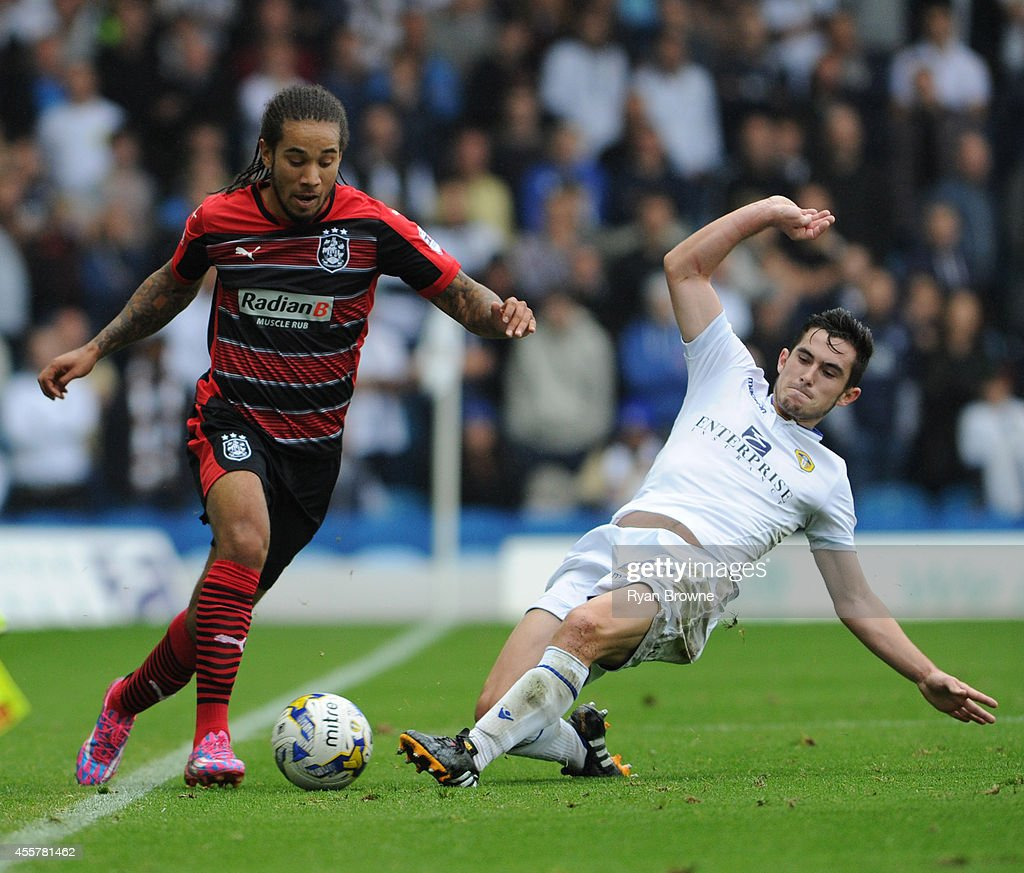 Lewis Cook (L) of Leeds vies with Sean Scannell of Huddersfield Town during Sky Bet Championship match between Leeds United and Huddersfield Town at Elland Road Stadium on September 20, 2014 in Leeds, United Kingdom.