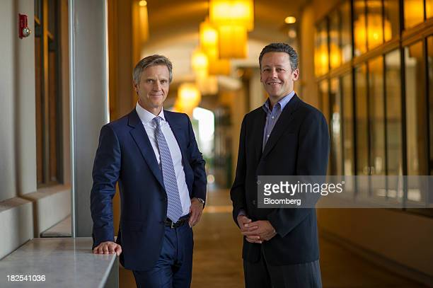 Lewis Dickey chairman and chief executive officer of Cumulus Media inc left and Drew Larner chief executive officer of Rdio Inc stand for a...