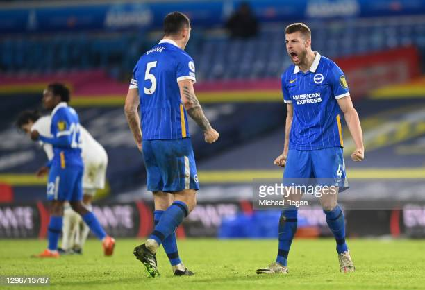 Lewis Dunk and Adam Webster of Brighton and Hove Albion celebrate following their team's victory in the Premier League match between Leeds United and...