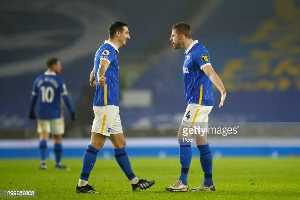 Lewis Dunk and Adam Webster of Brighton & Hove Albion celebrate at full time after the Premier League match between Brighton & Hove Albion and...