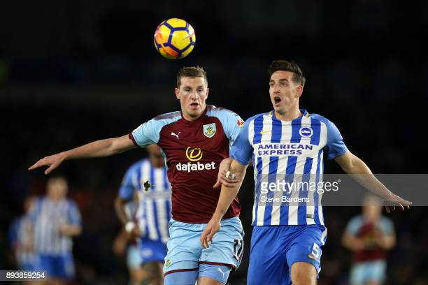 Lewis Dunk of Brighton and Hove Albion and Chris Wood of Burnley battles for possesion during the Premier League match between Brighton and Hove...