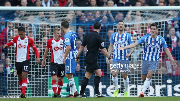 Lewis Dunk of Brighton and Hove Albion appeals to referee Neil Swarbrick during the Premier League match between Brighton and Hove Albion and...