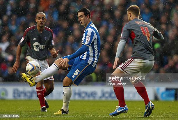 Lewis Dunk of Brighton and Hove Albion avoids Matt Mills of Bolton Wanderers during the npower Championship match between Brighton Hove Albion and...