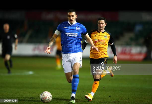 Lewis Dunk of Brighton and Hove Albion battles for possession with Padraig Amond of Newport County during the FA Cup Third Round match between...