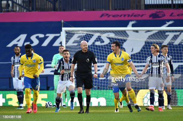 Lewis Dunk of Brighton and Hove Albion celebrates after scoring a goal from a quickly taken free kick, which is later disallowed following a VAR...