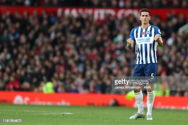 Lewis Dunk of Brighton and Hove Albion celebrates after scoring a goal to make it 21 during the Premier League match between Manchester United and...