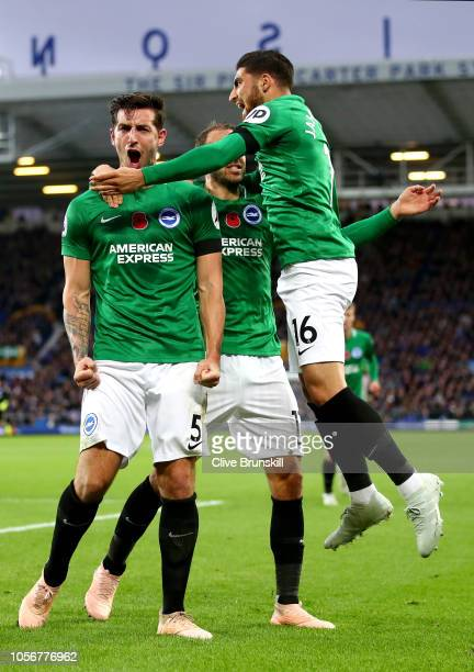 Lewis Dunk of Brighton and Hove Albion celebrates after scoring his team's first goal with his team mates during the Premier League match between...