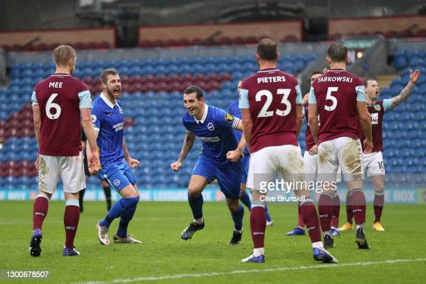 Lewis Dunk of Brighton and Hove Albion celebrates after scoring his team's first goal during the Premier League match between Burnley and Brighton &...