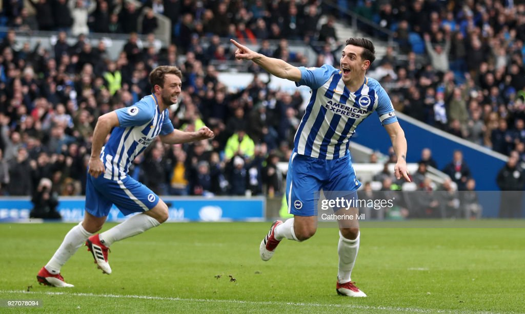 Lewis Dunk of Brighton and Hove Albion celebrates after scoring his sides first goal during the Premier League match between Brighton and Hove Albion and Arsenal at Amex Stadium on March 4, 2018 in Brighton, England.
