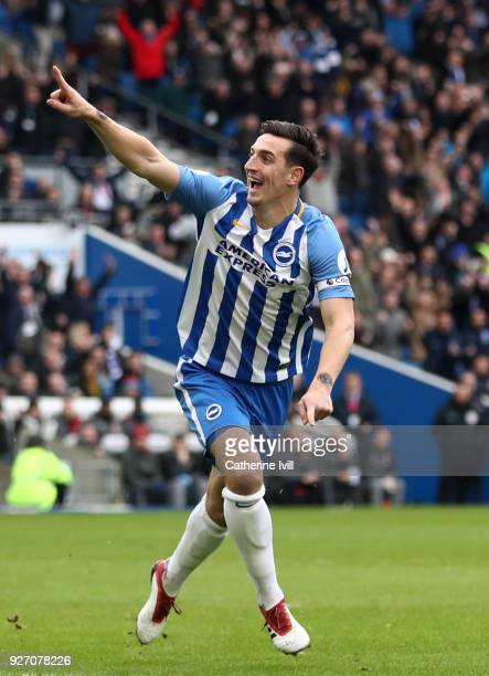 Lewis Dunk of Brighton and Hove Albion celebrates after scoring his sides first goal during the Premier League match between Brighton and Hove Albion...