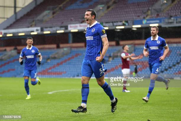 Lewis Dunk of Brighton and Hove Albion celebrates after scoring their side's first goal during the Premier League match between Burnley and Brighton...
