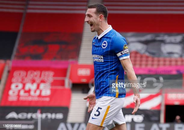 Lewis Dunk of Brighton and Hove Albion celebrates after scoring their side's first goal during the Premier League match between Southampton and...