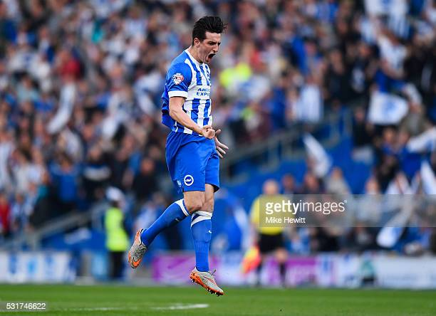 Lewis Dunk of Brighton and Hove Albion celebrates as he scores their first goal during the Sky Bet Championship Play Off semi final second leg match...