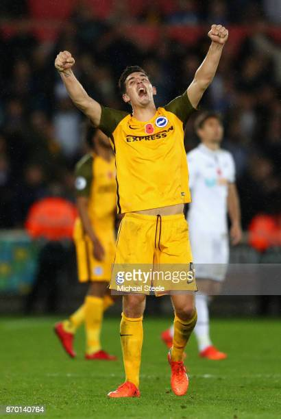Lewis Dunk of Brighton and Hove Albion celebrates his side's win following the Premier League match between Swansea City and Brighton and Hove Albion...