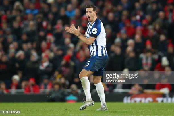 Lewis Dunk of Brighton and Hove Albion celebrates his team's first goal during the Premier League match between Liverpool FC and Brighton Hove Albion...