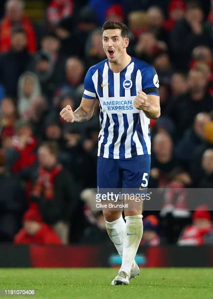 Lewis Dunk of Brighton and Hove Albion celebrates his team's first goal during the Premier League match between Liverpool FC and Brighton & Hove...
