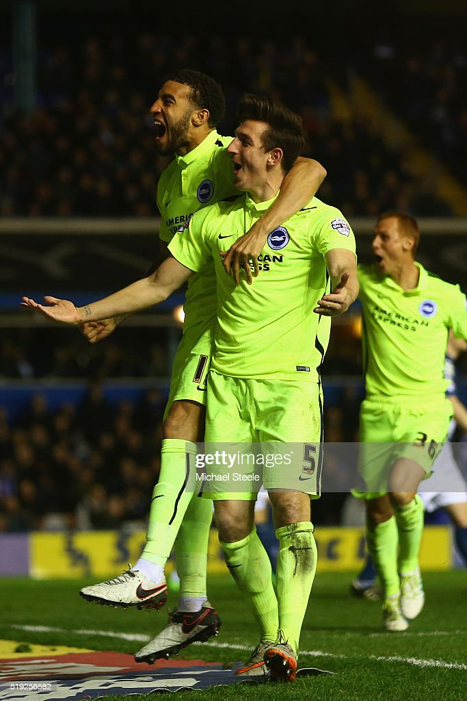 Lewis Dunk (R) of Brighton and Hove Albion celebrates scoring his sides second goal alongside Connor Goldson (L) during the Sky Bet Championship match between Birmingham City and Brighton and Hove Albion at St Andrews on April 5, 2016 in Birmingham, United Kingdom.
