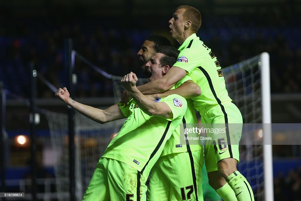 Lewis Dunk (L) of Brighton and Hove Albion celebrates scoring his sides second goal alongside Connor Goldson and Steve Sidwell during the Sky Bet Championship match between Birmingham City and Brighton and Hove Albion at St Andrews on April 5, 2016 in Birmingham, United Kingdom.