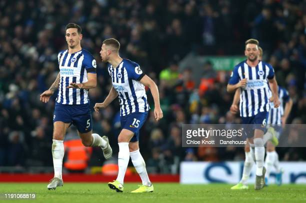 Lewis Dunk of Brighton and Hove Albion celebrates scoring his teams first goal during the Premier League match between Liverpool FC and Brighton Hove...
