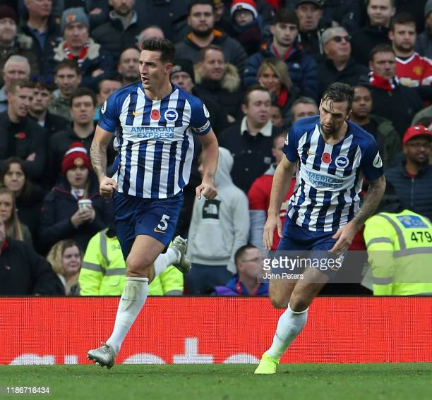 Lewis Dunk of Brighton and Hove Albion celebrates scoring their first goal during the Premier League match between Manchester United and Brighton...