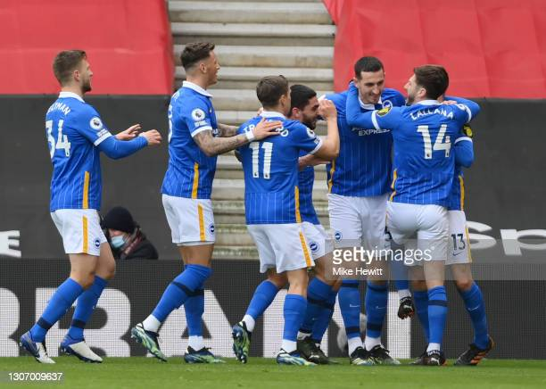 Lewis Dunk of Brighton and Hove Albion celebrates with Joel Veltman, Ben White, Leandro Trossard, Adam Lallana and Pascal Gross after scoring their...