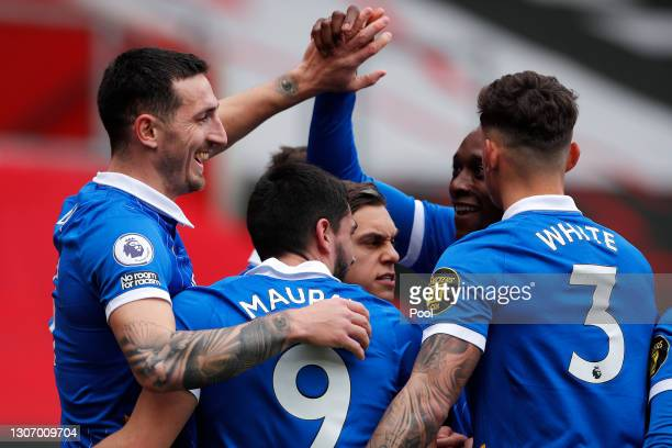 Lewis Dunk of Brighton and Hove Albion celebrates with Neal Maupay and Ben White after scoring their side's first goal during the Premier League...