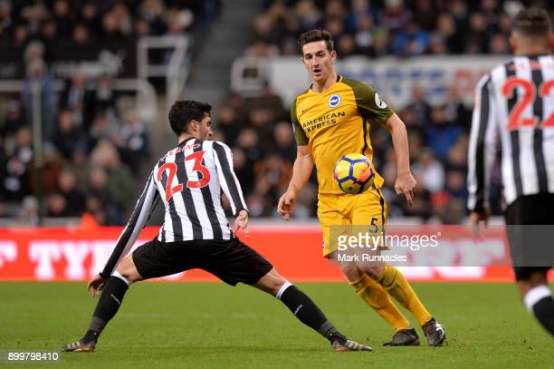 Lewis Dunk of Brighton and Hove Albion is challenged by Mikel Merino of Newcastle United during the Premier League match between Newcastle United and...
