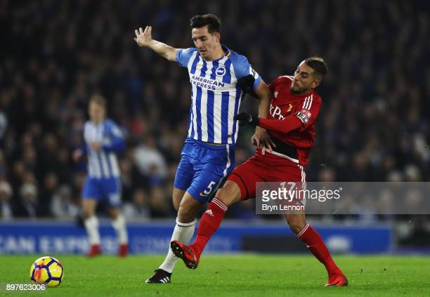 Lewis Dunk of Brighton and Hove Albion is challenged by Roberto Pereyra of Watford during the Premier League match between Brighton and Hove Albion...