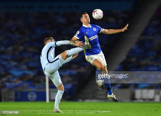 Lewis Dunk of Brighton and Hove Albion is challenged by Timo Werner of Chelsea during the Premier League match between Brighton & Hove Albion and...
