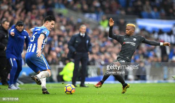Lewis Dunk of Brighton and Hove Albion is put under pressure by Charly Musonda of Chelsea during the Premier League match between Brighton and Hove...