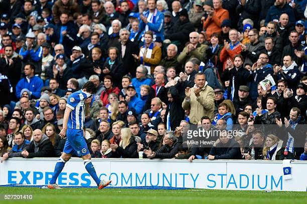 Lewis Dunk of Brighton and Hove Albion leaves the pitch after being red carded during the Sky Bet Championship match between Brighton and Hove Albion...